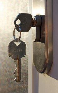 Image of House Key in Door