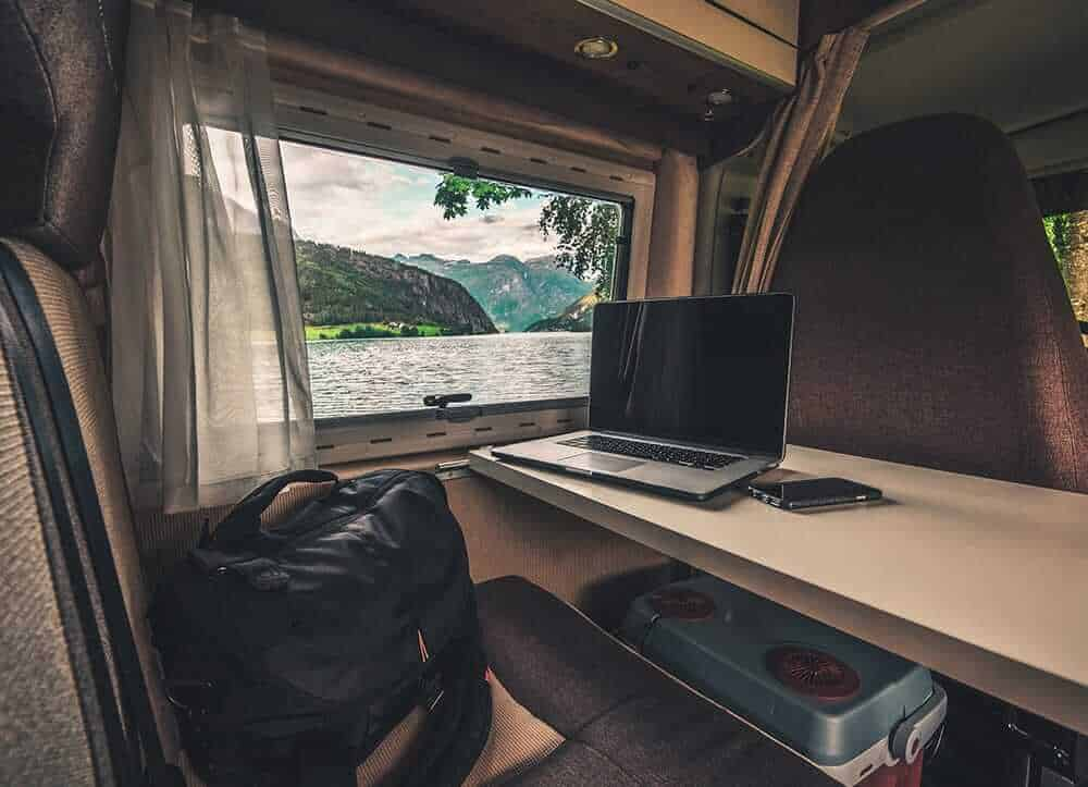 window of motorhome with a view on a lake