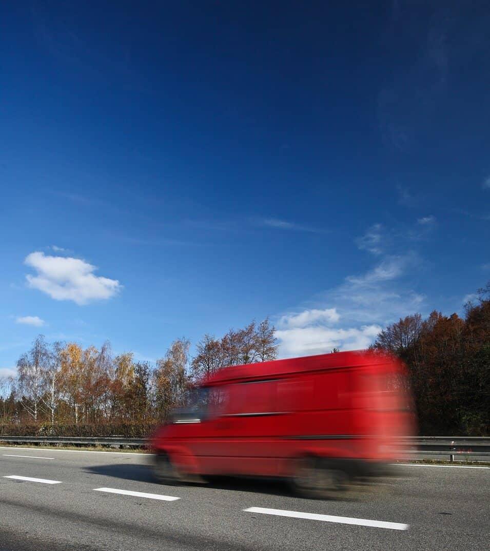 Van driving on main road