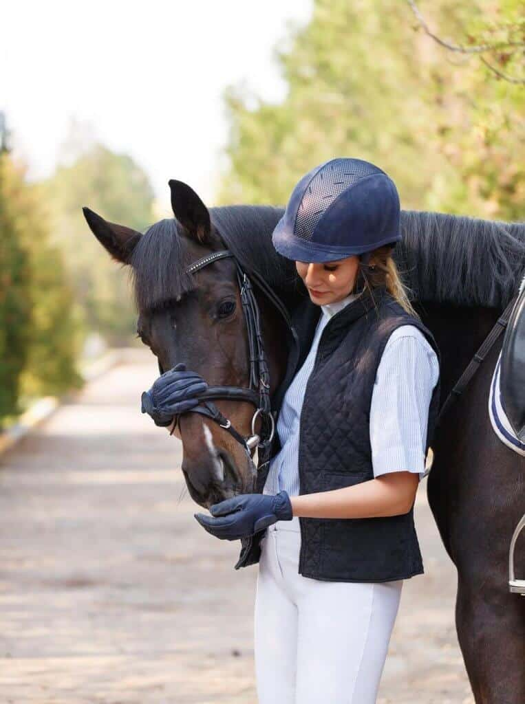 Horse rider with her horse