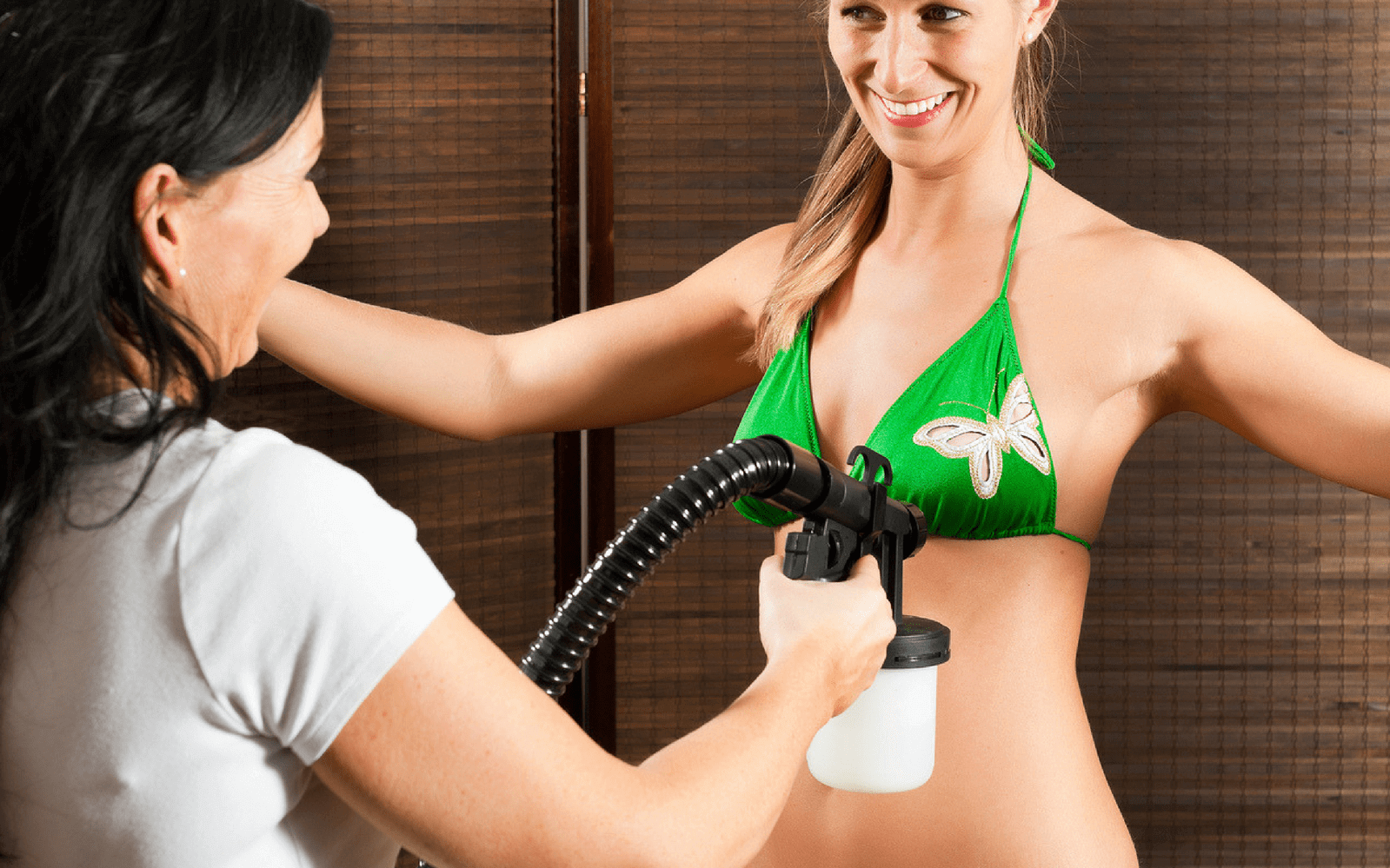 Woman being spray tanned