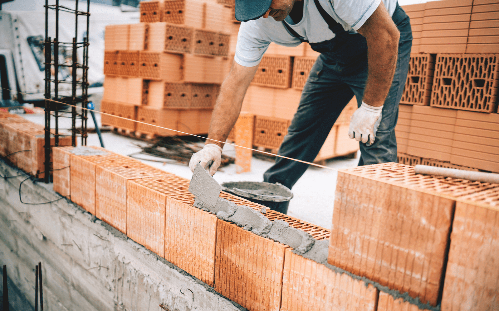 Worker laying bricks for wall