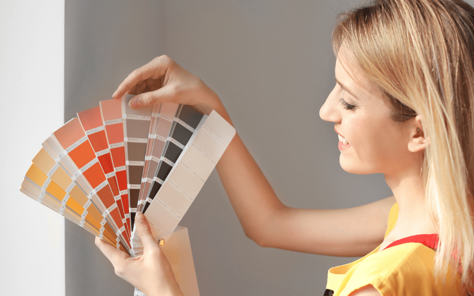 Female decorator looking at paint samples