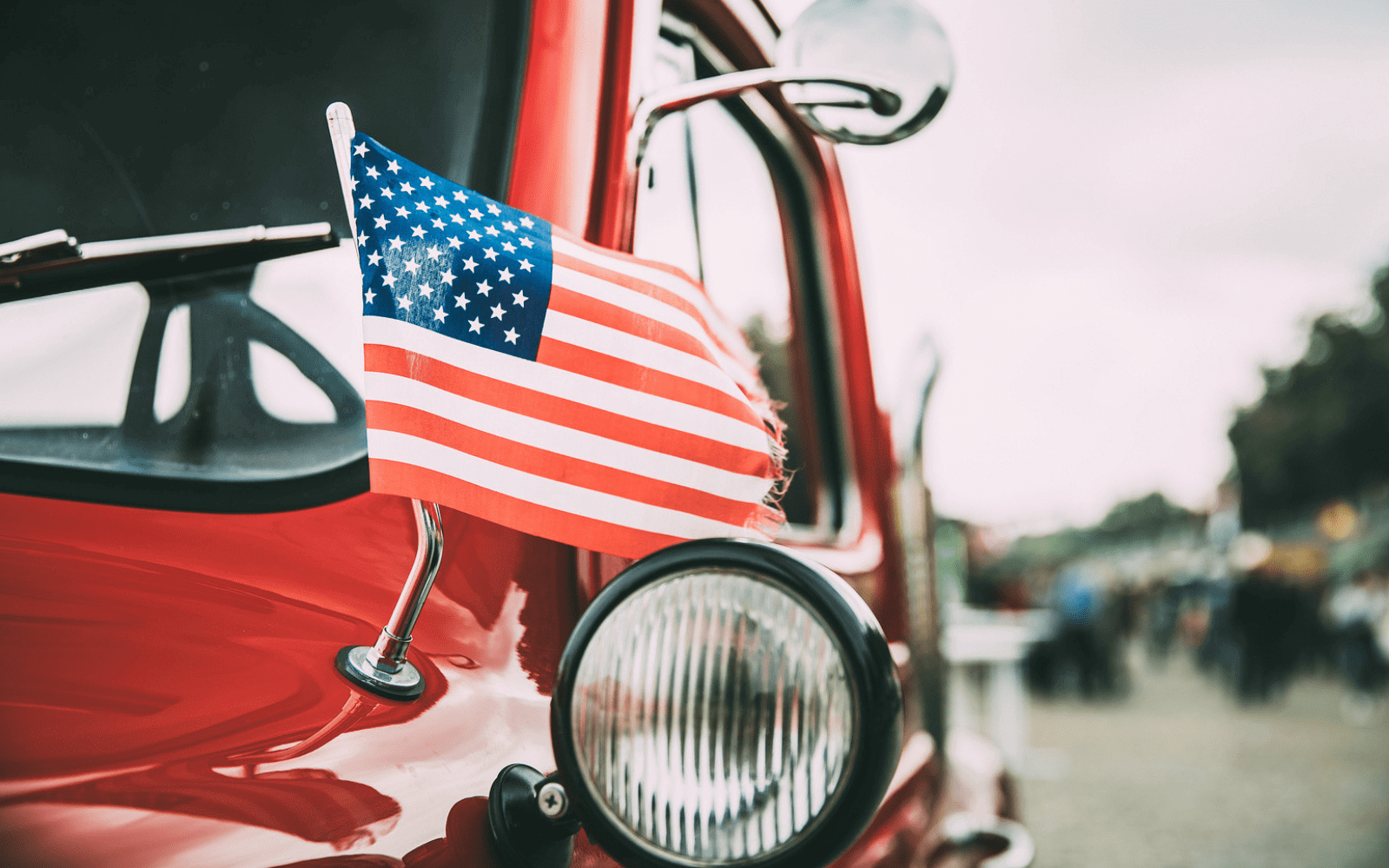 Red truck with American flag