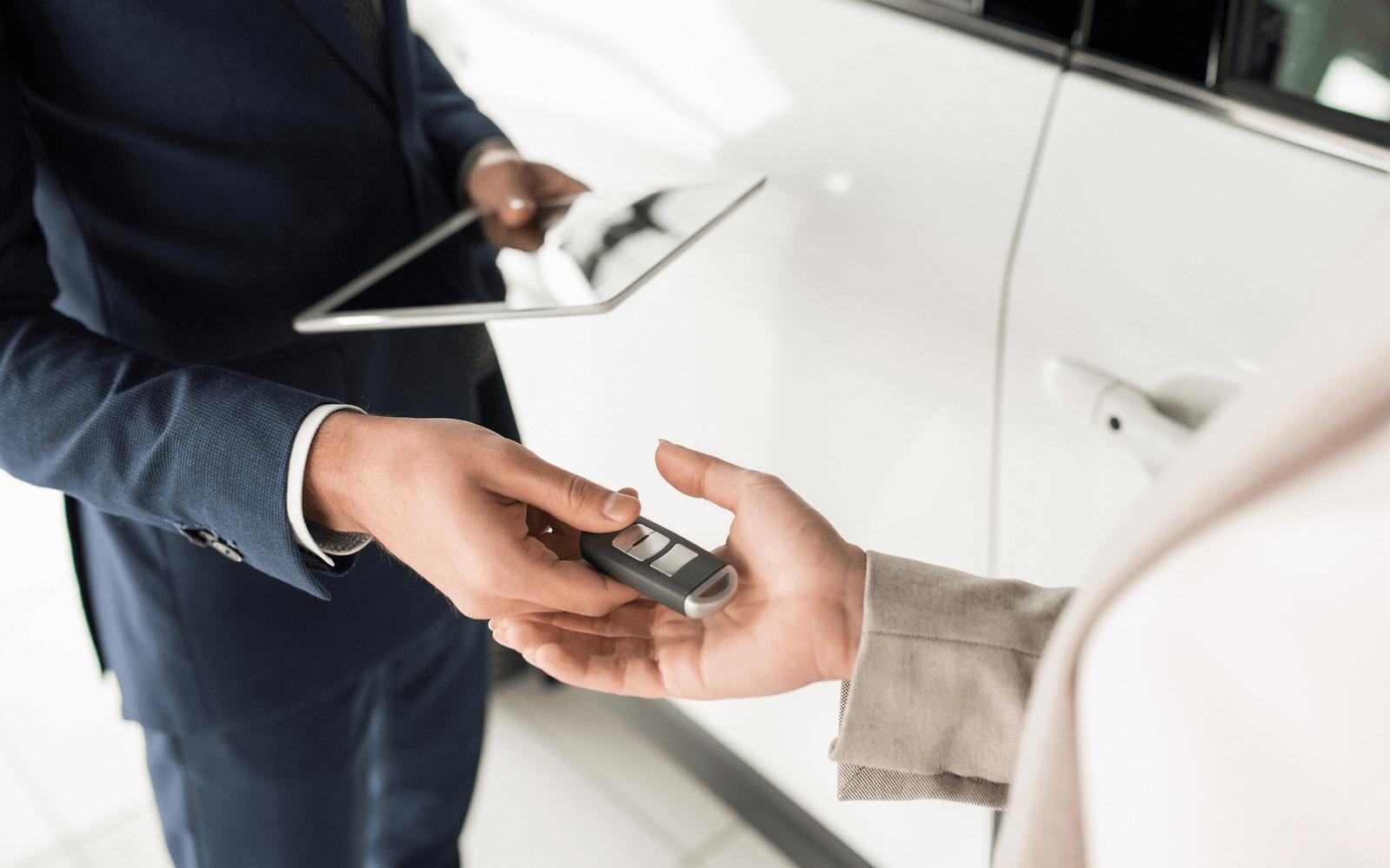 Handing over keys to new owner