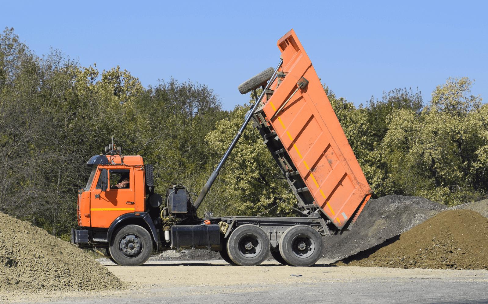 Dump truck in motion
