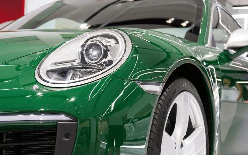 Front of green Porsche