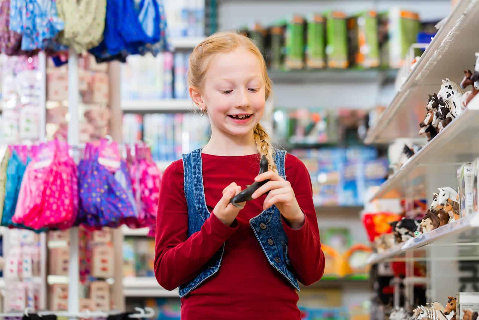 Girl choosing toy