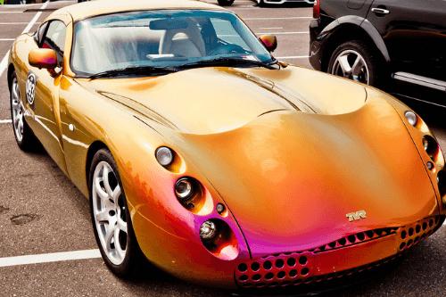 Orange TVR in car park