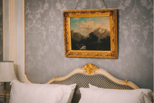Hotel bed with painting above