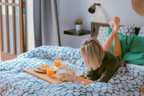 Woman enjoying breakfast in bed