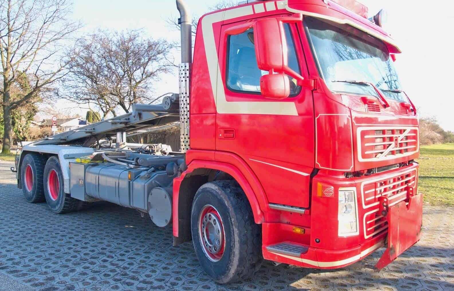 Red skip lorry