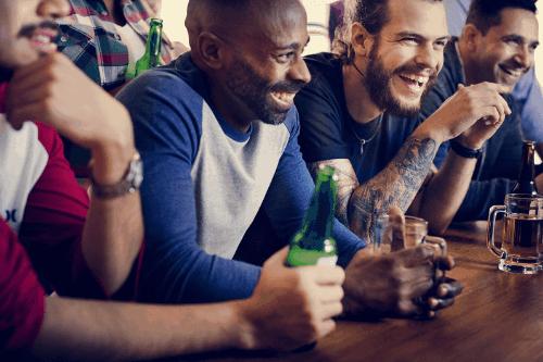 Friends cheering at sports bar