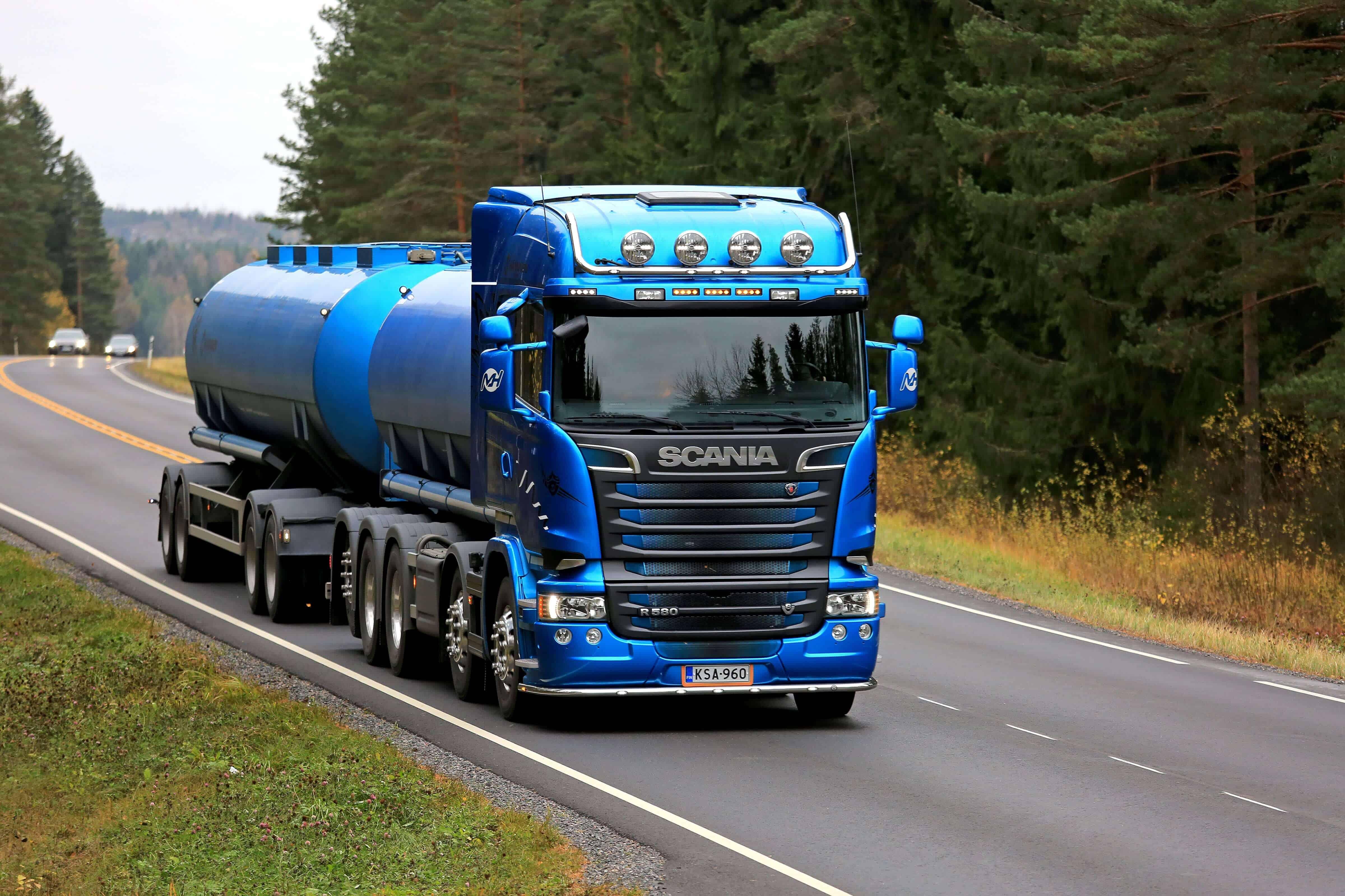 Blue truck hauling materials