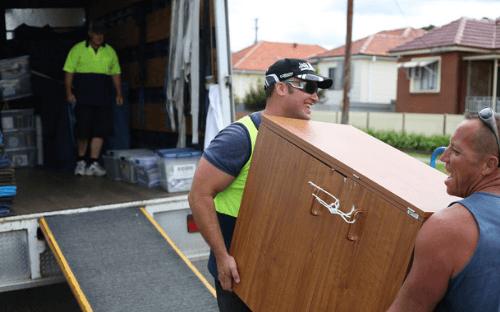 Men loading removals van