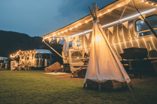 Airstream caravan with fairy lights