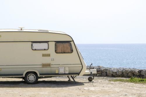 Caravan in front of ocean