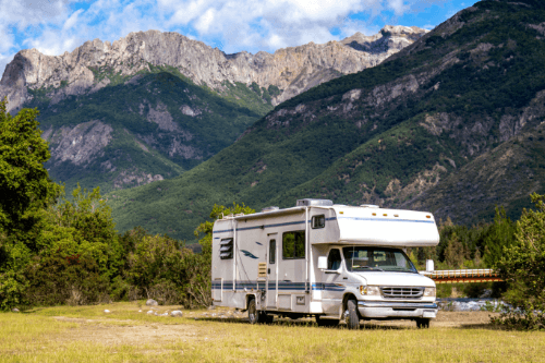 Motorhome in front of scenic mountains