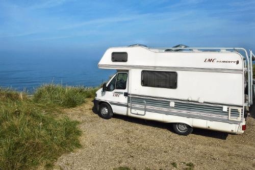 LMC caravan overlooking ocean
