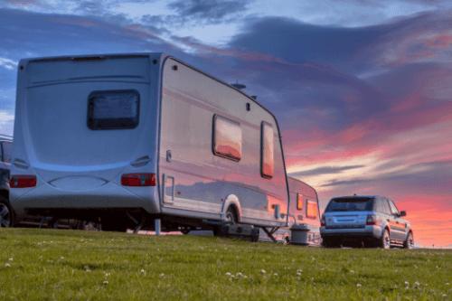 Caravan in front of sunset