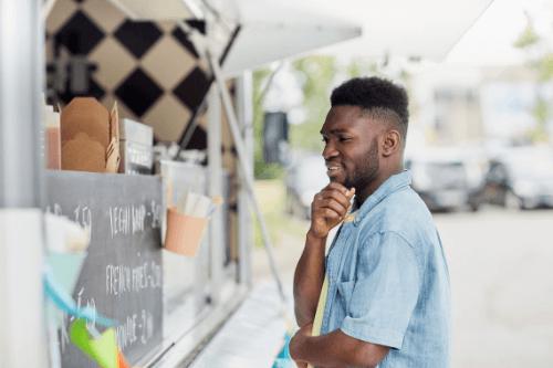 Man choosing food at van