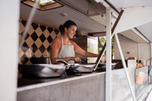 Woman serving food from van