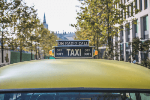 Taxi sign on top of car