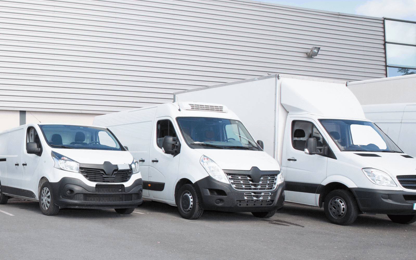Small fleet of different sized vans
