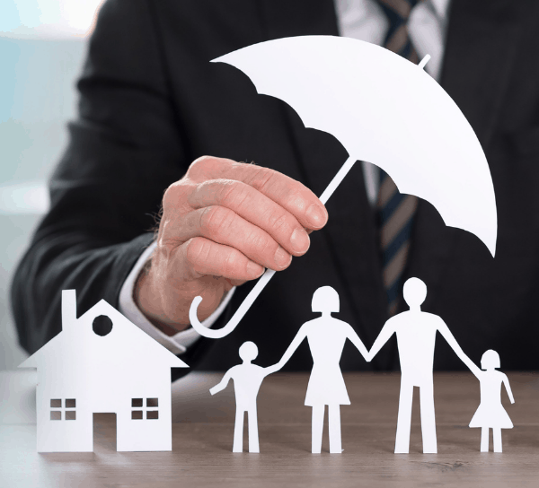 Man holding umbrella over family