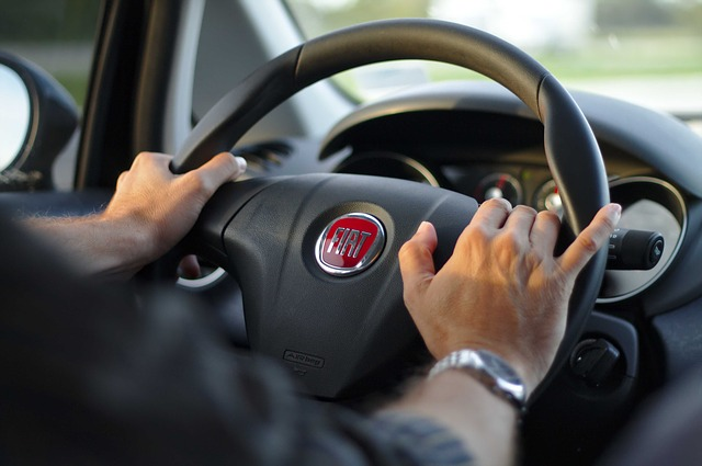 Image of hands on steering wheel